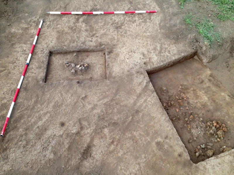 Type 1 hearth of stone and clay (left) with Type 2 hearth entirely of clay, found at a slightly lower level (right).  (See  Plates 4 and 5).